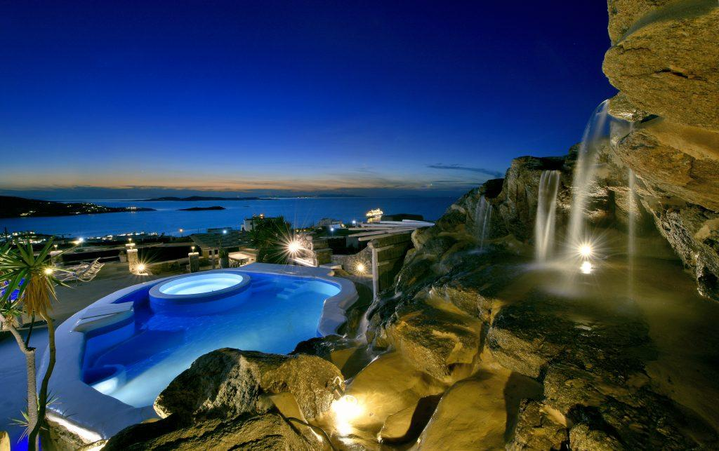 luxury stone waterfalls in the courtyard of a luxury villa