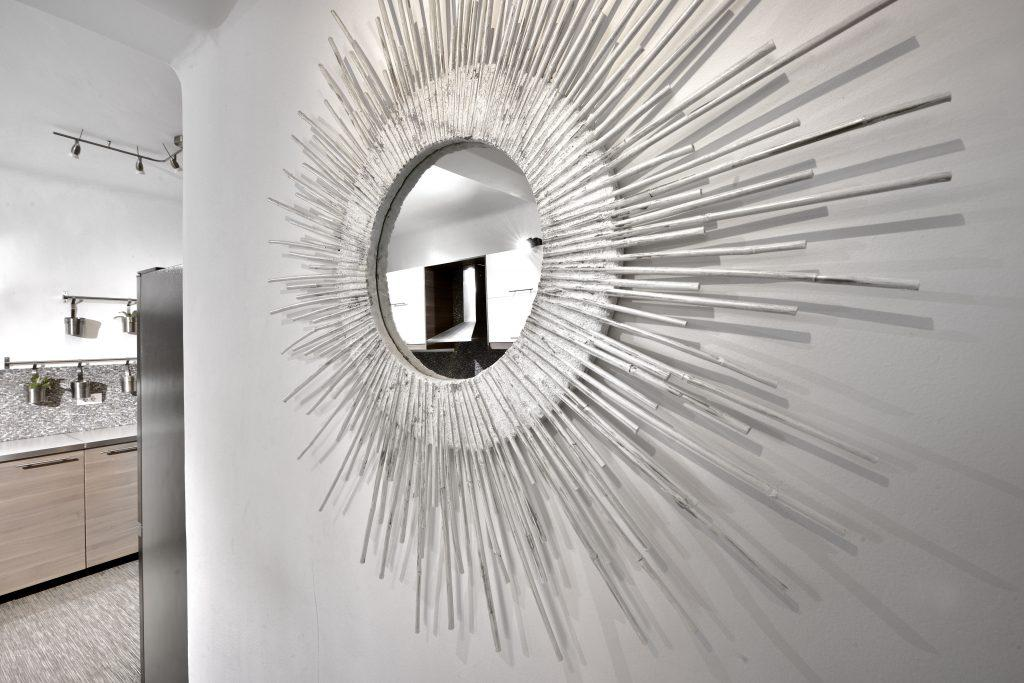 mirror with a modern frame that contributes to luxury accommodation