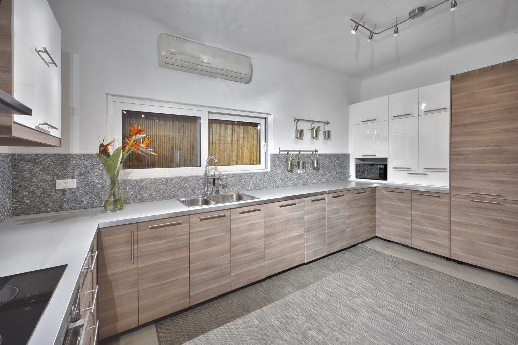 spacious kitchen with high-gloss white elements and wood