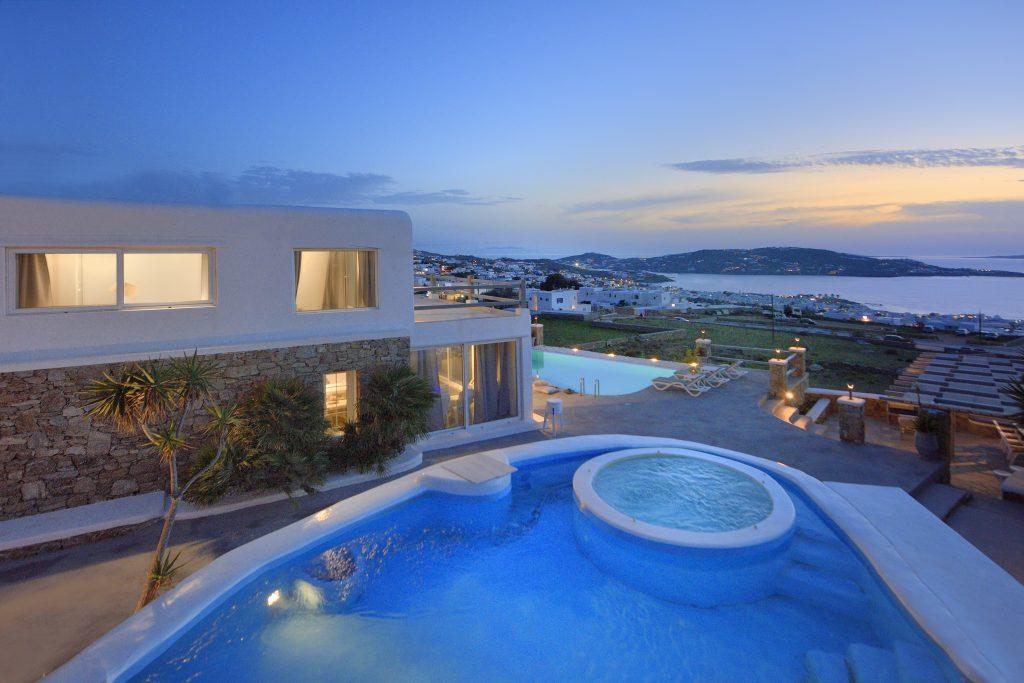 beautiful luxury villa with large illuminated pool and sea views
