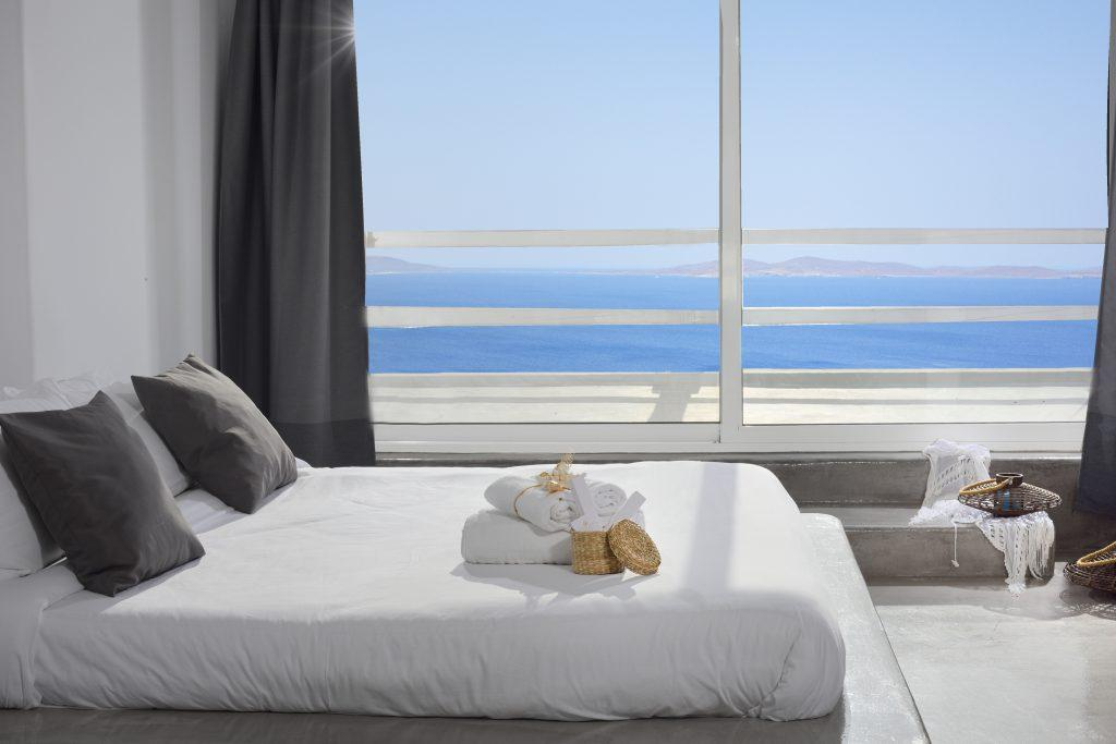 rom for two with cozy bed and overlooking the endlessly glistening blue sea
