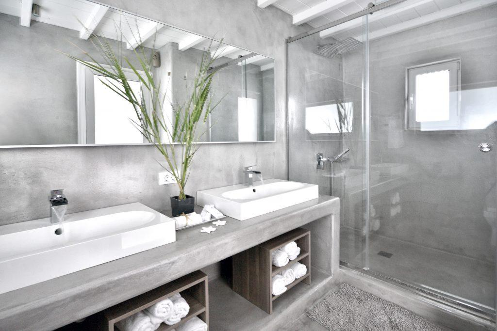 modern designed bathroom with gray tiles and glass shower ideal for two
