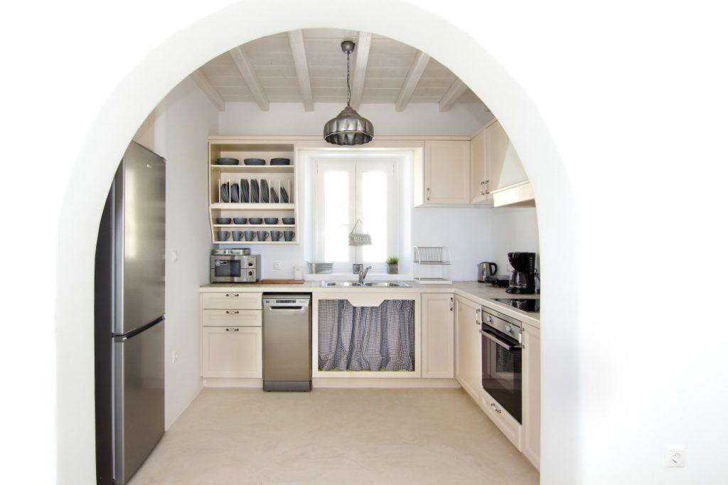 kitchen with white walls and wooden elements ideal for preparing delicious meals