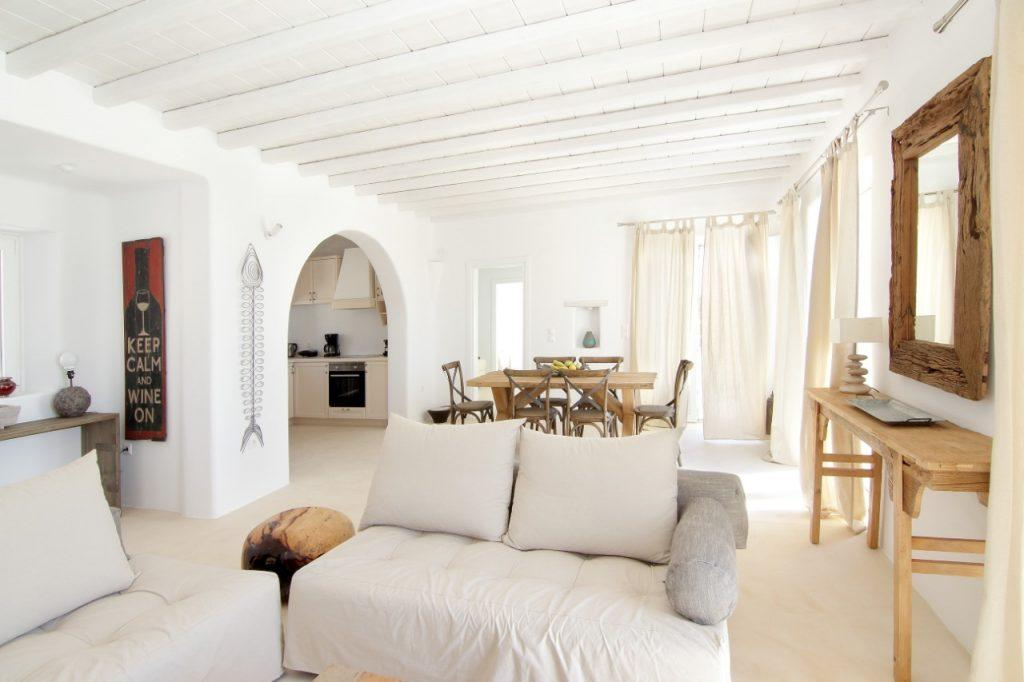 living room with white walls and cozy furniture ideal for relaxation