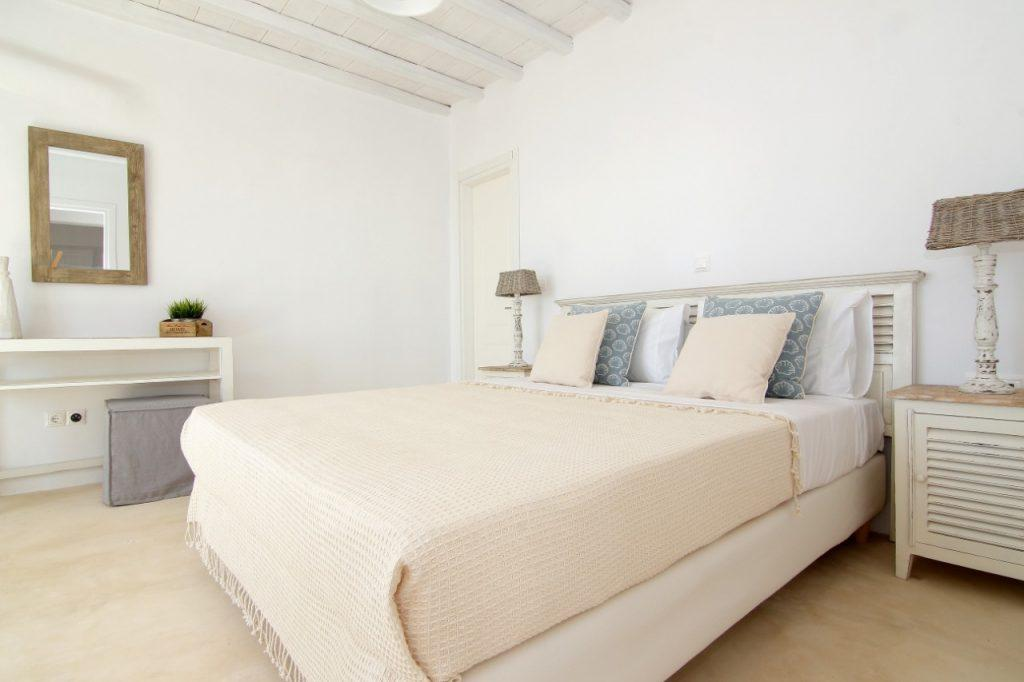soothing bedroom with white walls and light pink bedding ideal for sleeping and relaxing