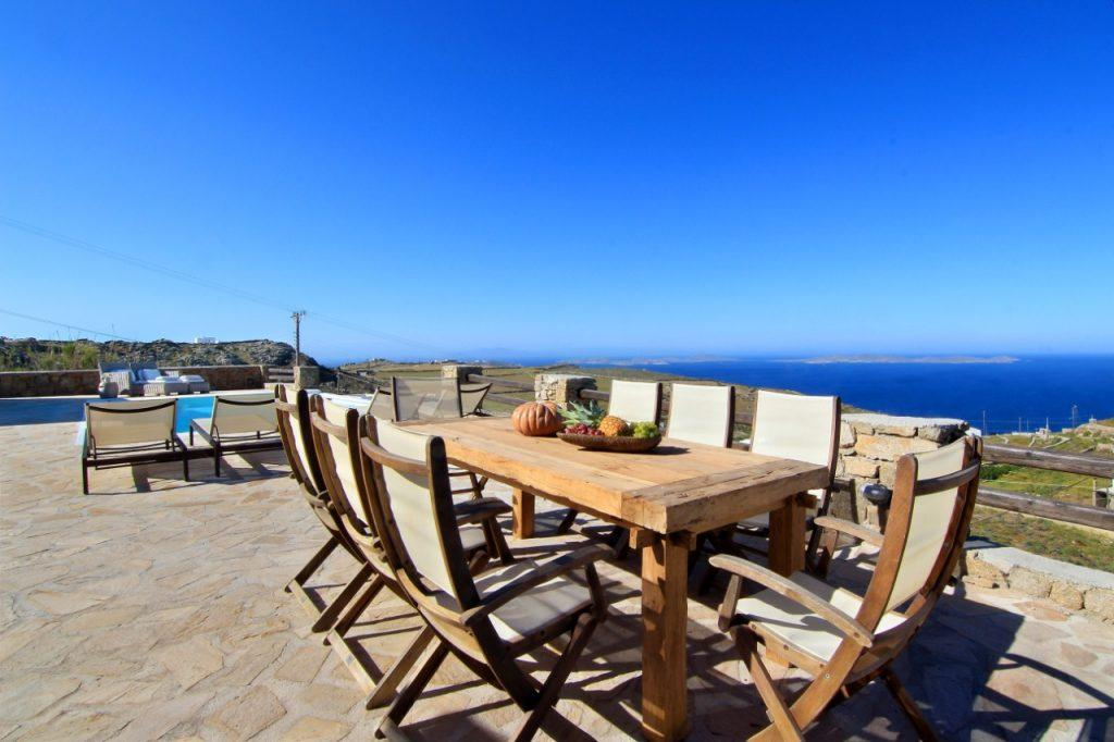 wooden table for lunch with friends in the courtyard of the villa