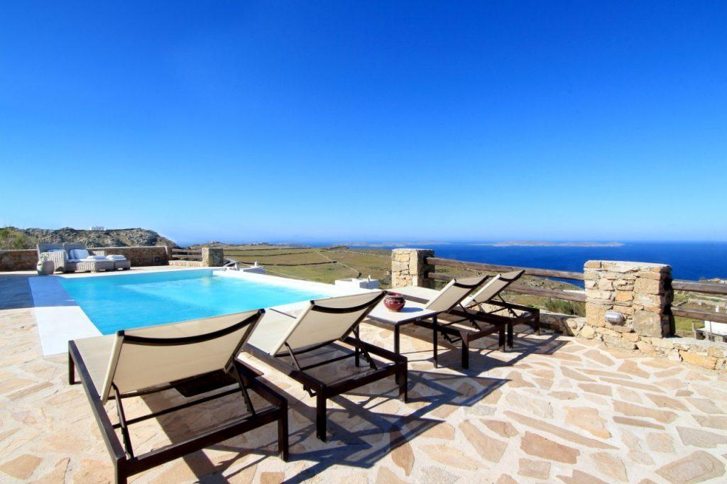 view of the crystal blue sea and nature from the pool of pleasant water