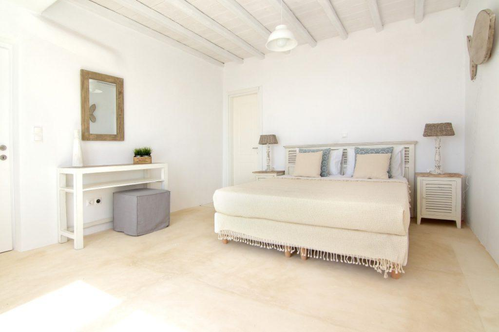 room for two with white walls cozy bed ideal for relaxation