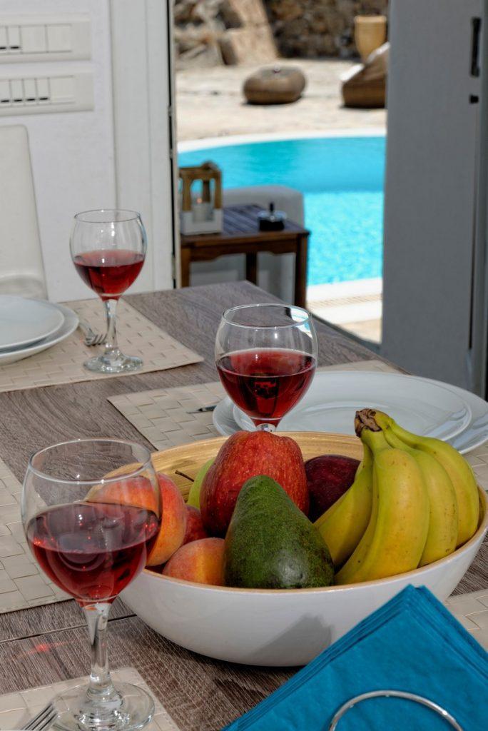 room with a dining table ideal for enjoying food and wine after a busy day