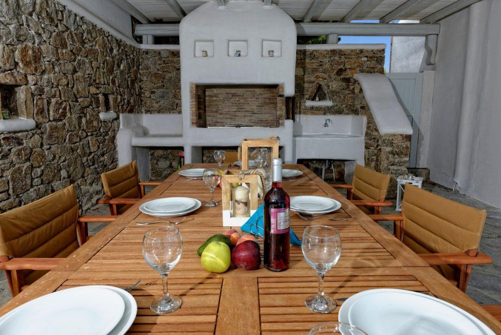 wooden table and cozy chairs ideal for enjoying food and drink