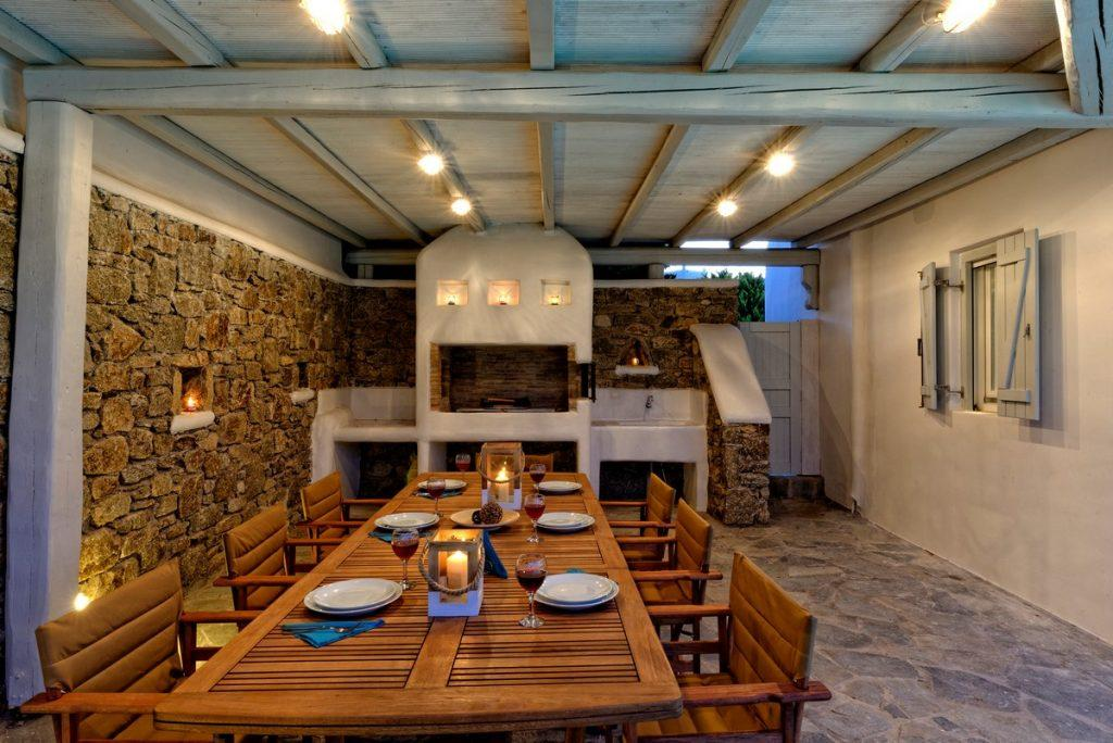 wooden table decorated with candles that contribute to a pleasant evening atmosphere ideal for enjoying food and drink