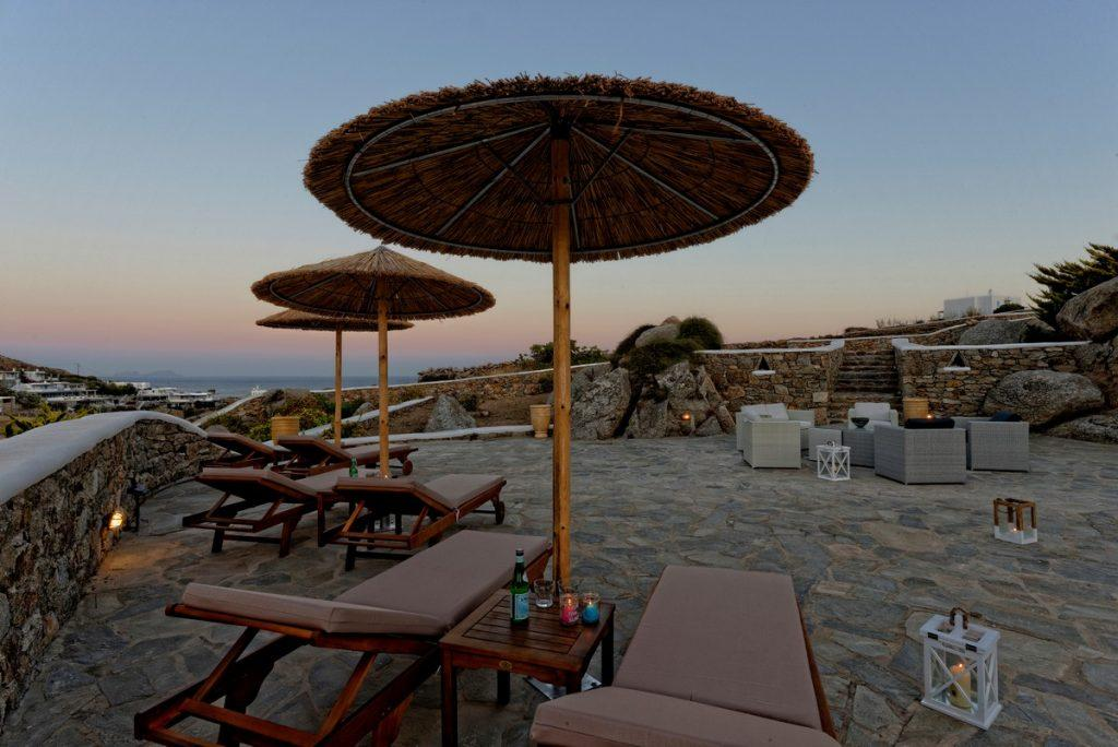 enchanting view of the sunset from the pleasantly landscaped courtyard of the villa