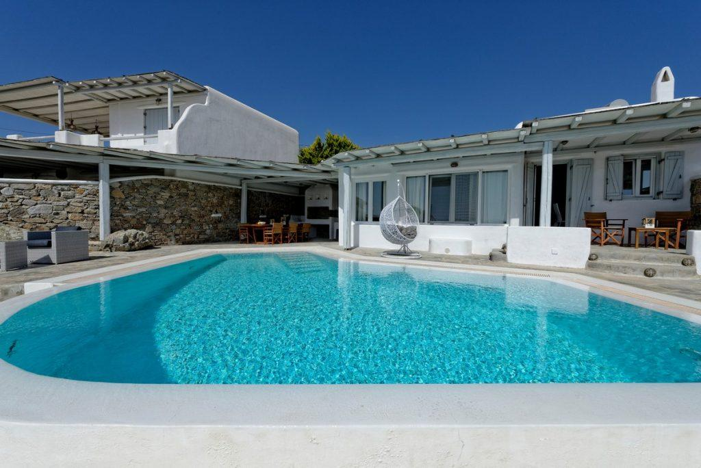 comfortable white swing by the pool pleasant water ideal for relaxation