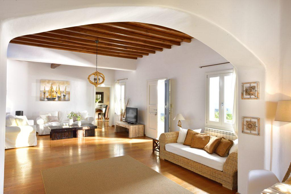 cozy living room with white walls, cream furniture and parquet