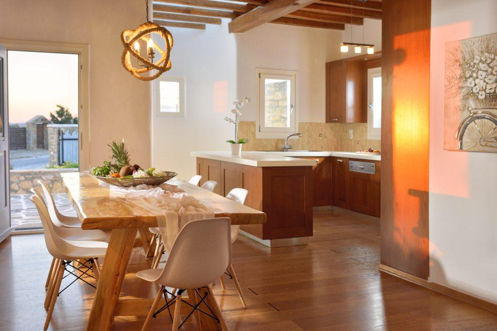 modern designed dining room with large wooden table and comfortable chairs perfect place for a pleasant lunch with the family