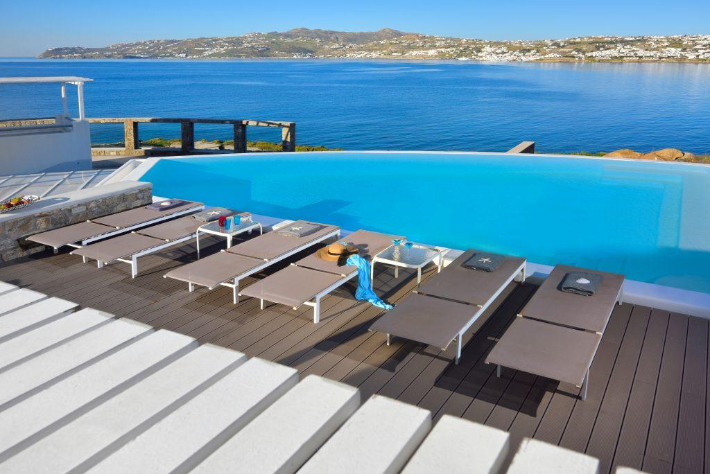 view of the bright blue sea and nature from the pool ideal for enjoyment
