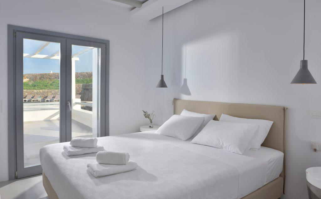 simply designed bedroom with access to the courtyard