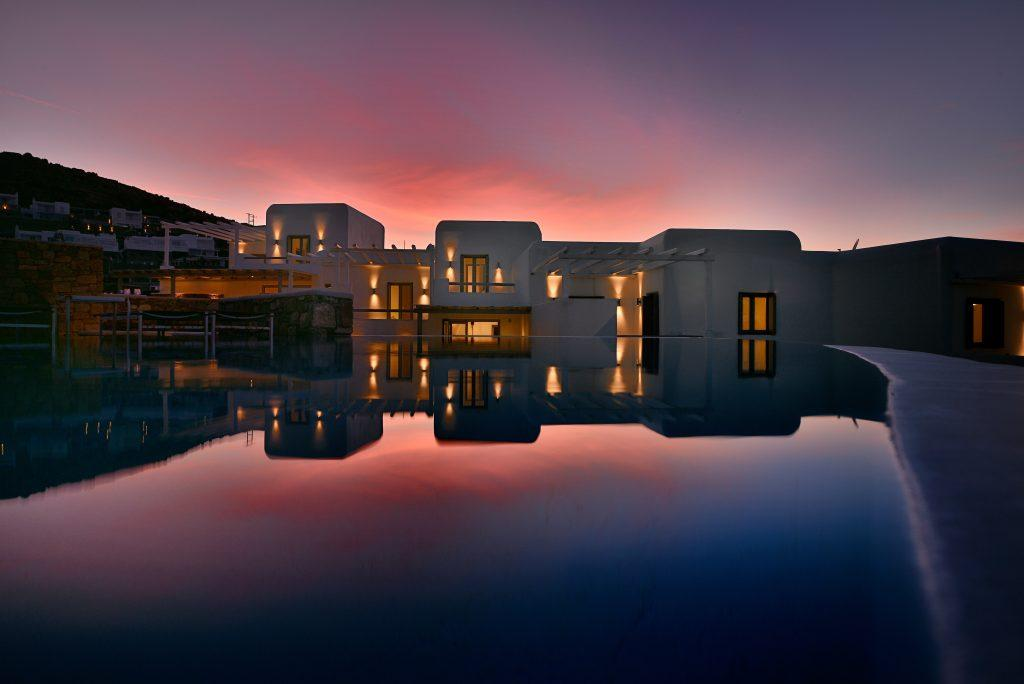breathtaking sunset view and a luxurious villa that makes it even more beautiful