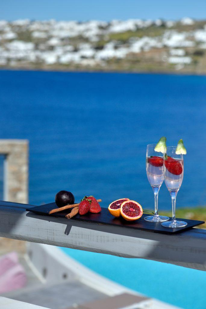 area overlooking the clear blue sea ideal for enjoying a refreshing drink and fruit