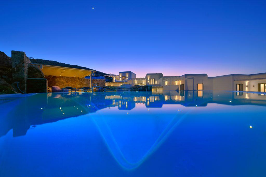 night view of a white luxury villa lit by lamps
