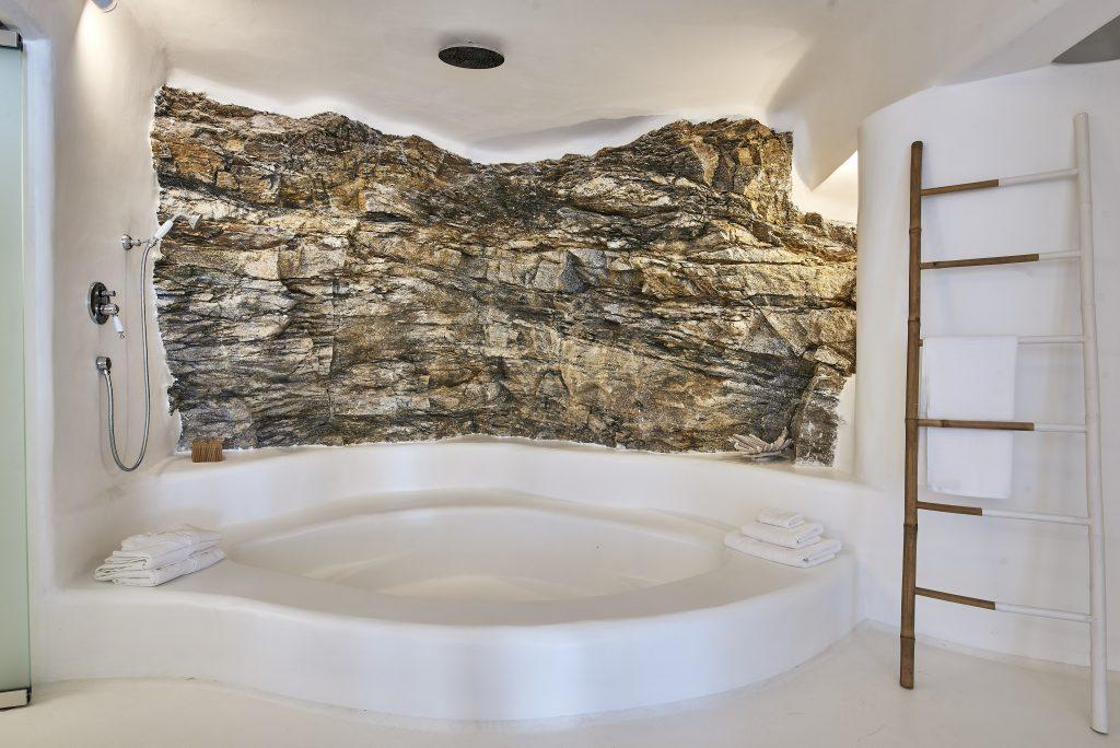 bathroom with a mixture of white and stone walls