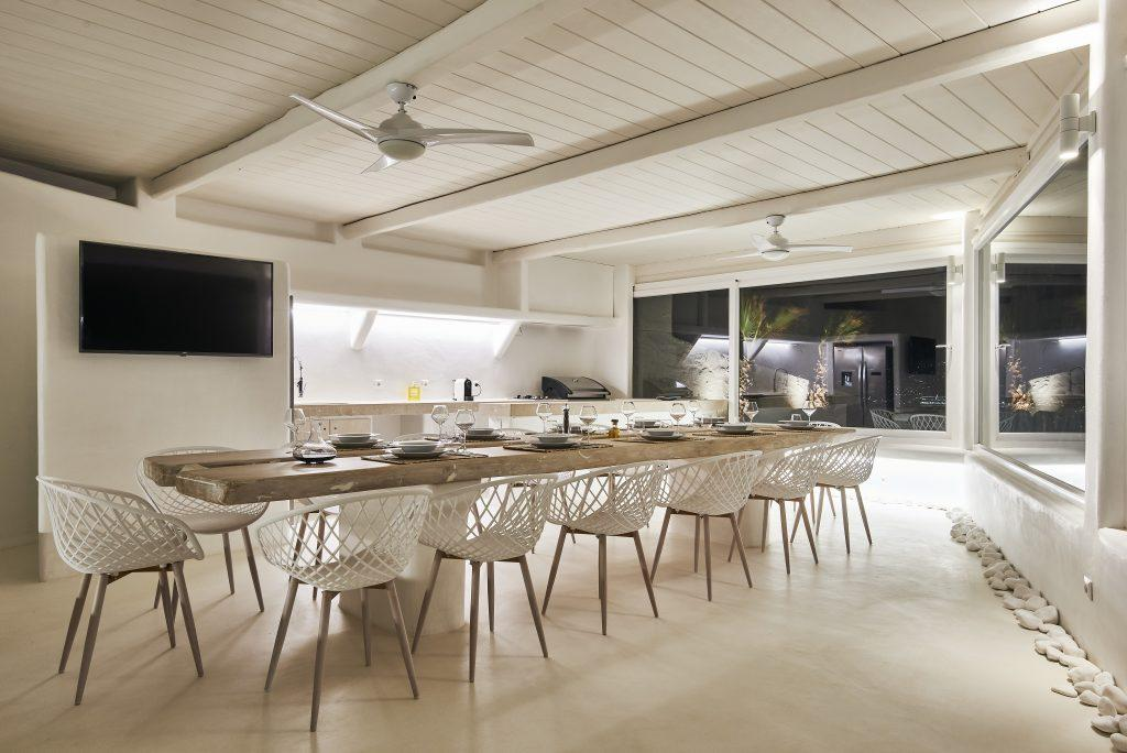 dining room with modern dining table and TV
