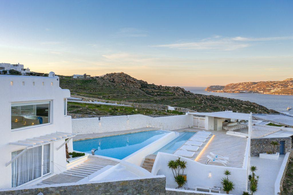 villa overlooking the crystal blue sea, beautiful city and nature