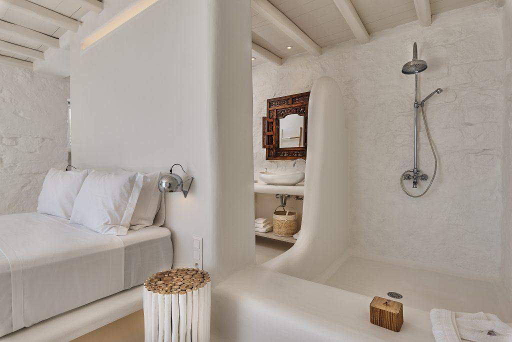 room with white walls and comfortable bed
