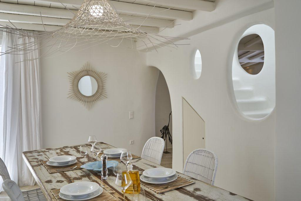 dining room with white walls and comfortable chairs