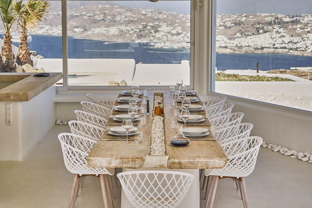 view of the crystal blue sea and the city ideal for a pleasant lunch with friends