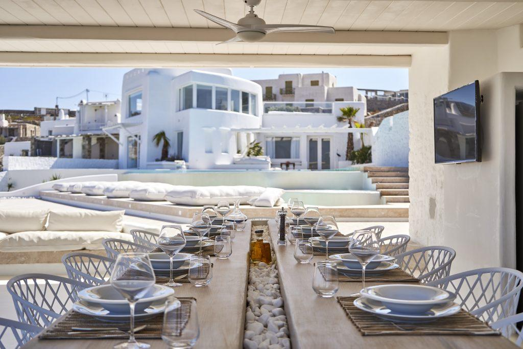 terrace with wooden canopy and large table ideal for outdoor lunch with friends