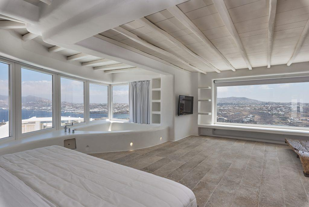 view of the sea and the city of Mykonos from a spacious bedroom
