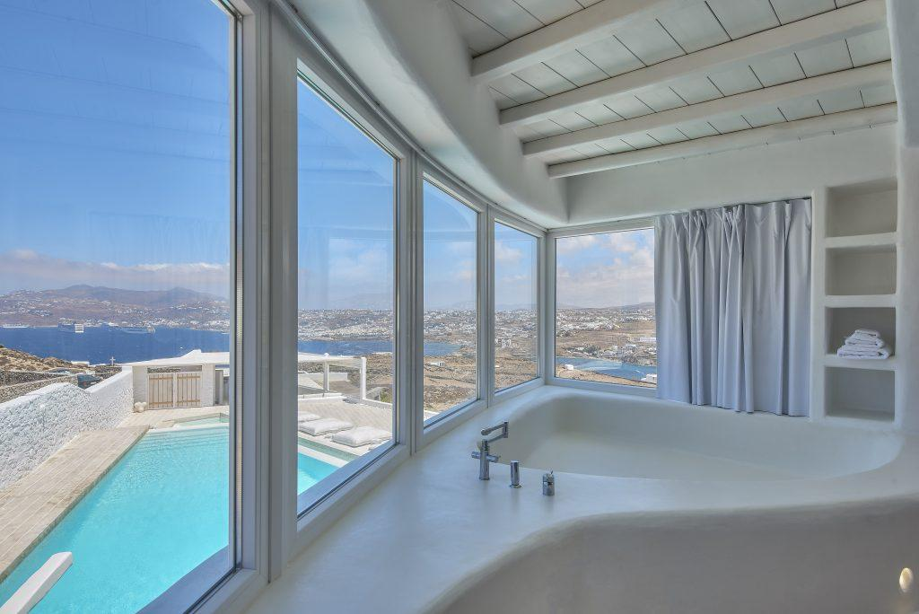 view from the jacuzzi to the crystal blue sea and the courtyard of the villa with pool ideal for a luxurious vacation