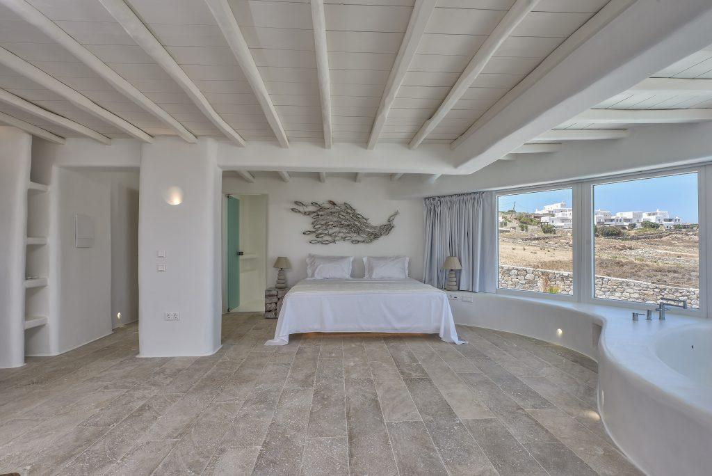 room with sea views and large windows that provide daylight