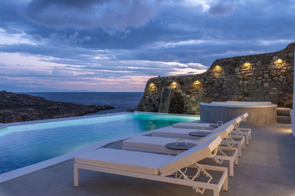 stone paved villa walls with candles for romantic night by the pool