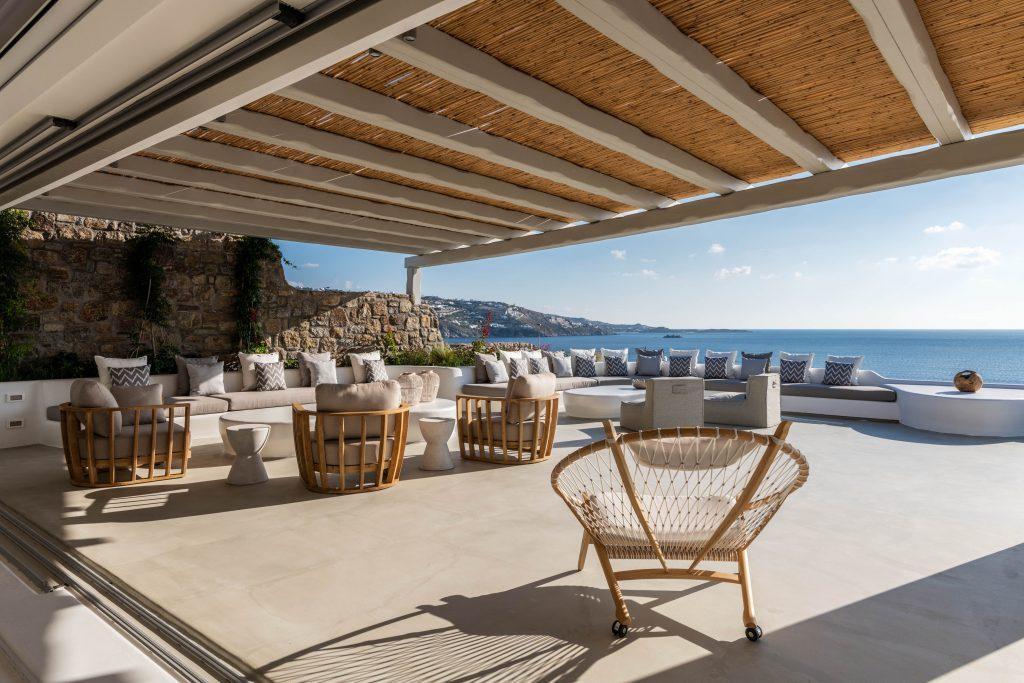 enormous open terrace with armchairs tables and couches ideal for family and friend gatherings