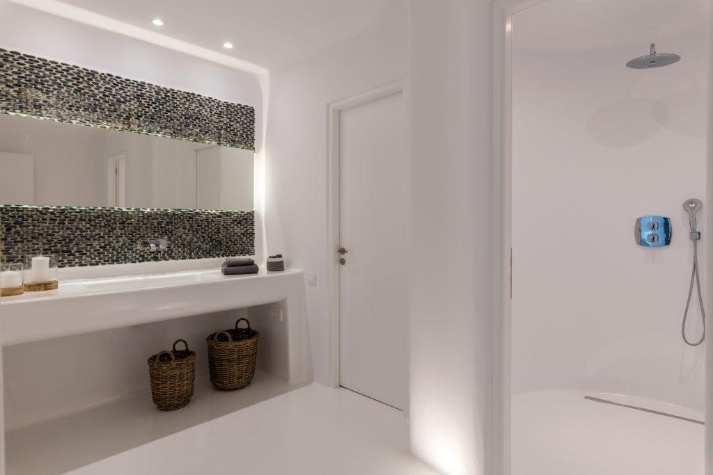 big mirror and extensive sink to get ready and take a shower before daily activities