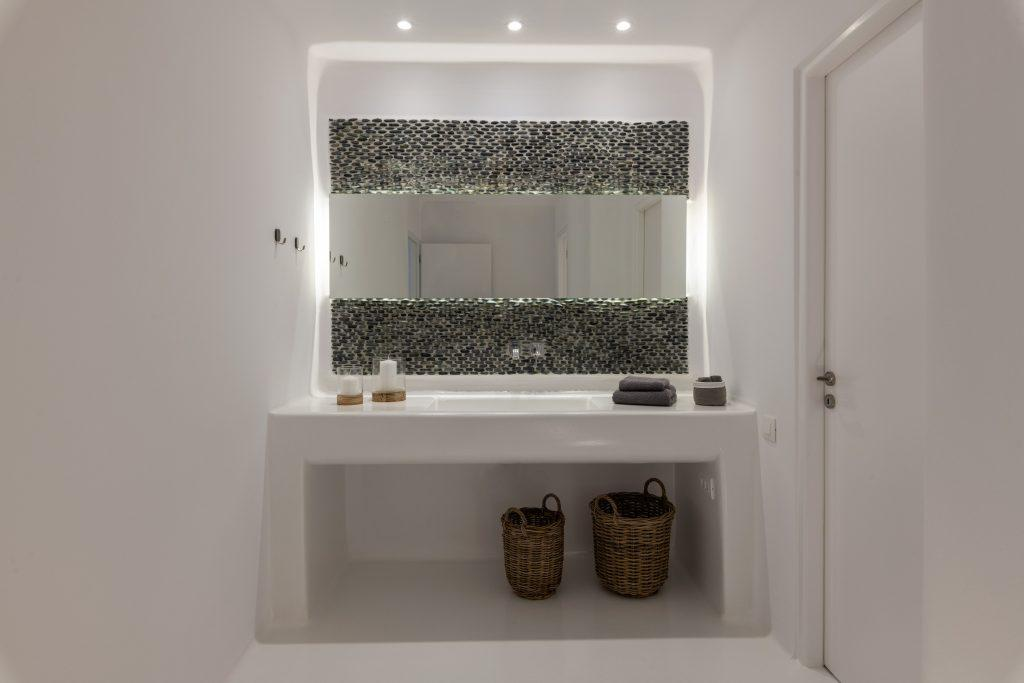 simply designed bathroom with wide ceramic sink covered with led lamps for better lightening