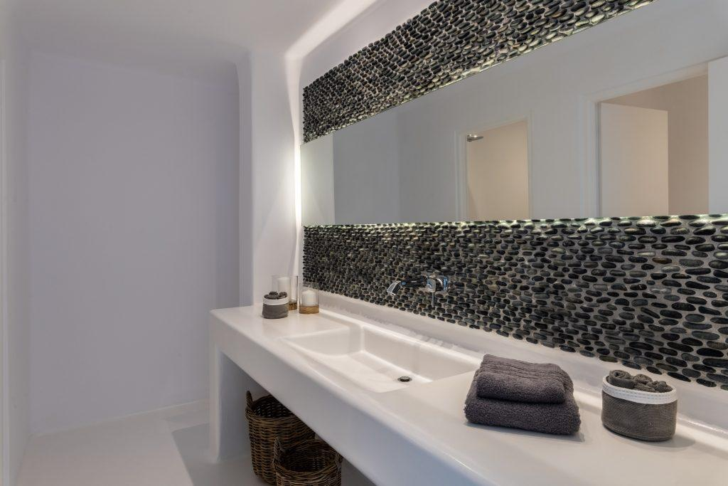 big mirror and extensive sink to get ready before daily activities