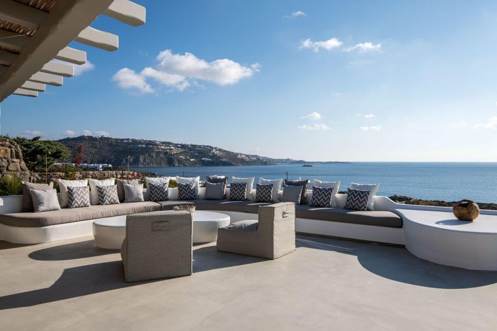 enough space on sofa and extra cushions to comfortably enjoy sea and island view in breeze of fresh air