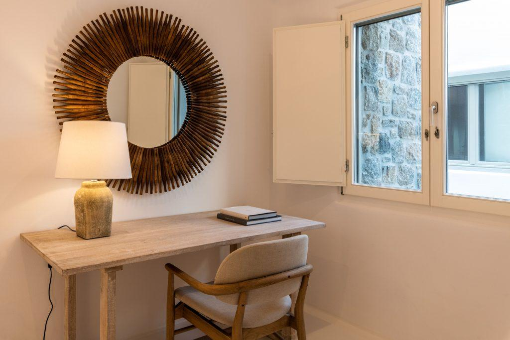 ideal place to put your laptop and sit down to do things you need to do next to the window for natural daylight and in front of round interesting mirror