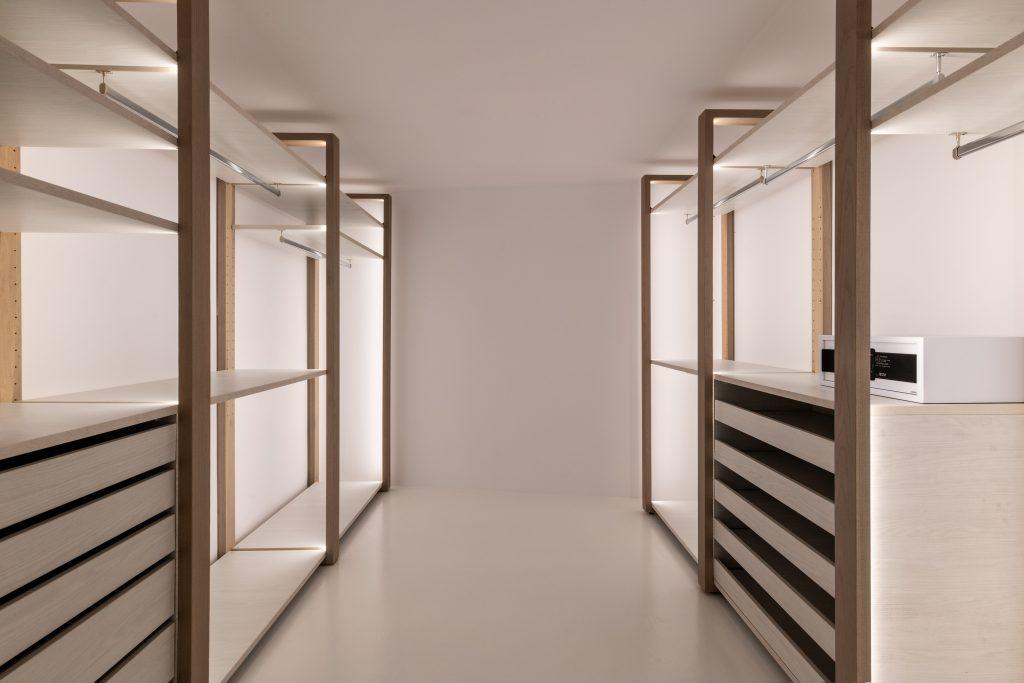 vast mirrored wardrobe cabinets for villa quests clothes