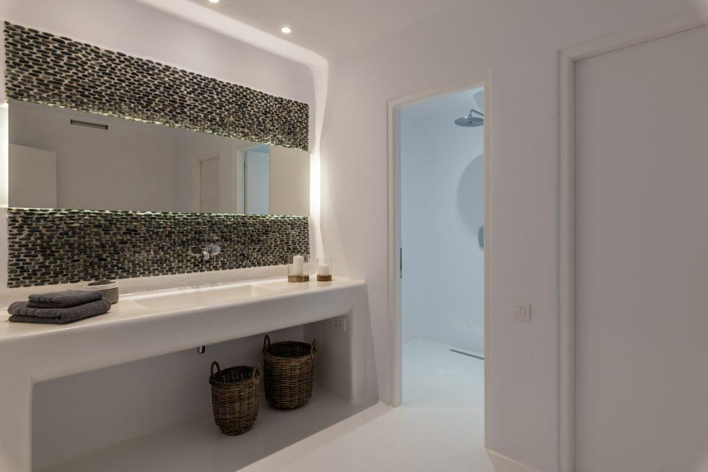 bathroom with huge mirror and shower cabin