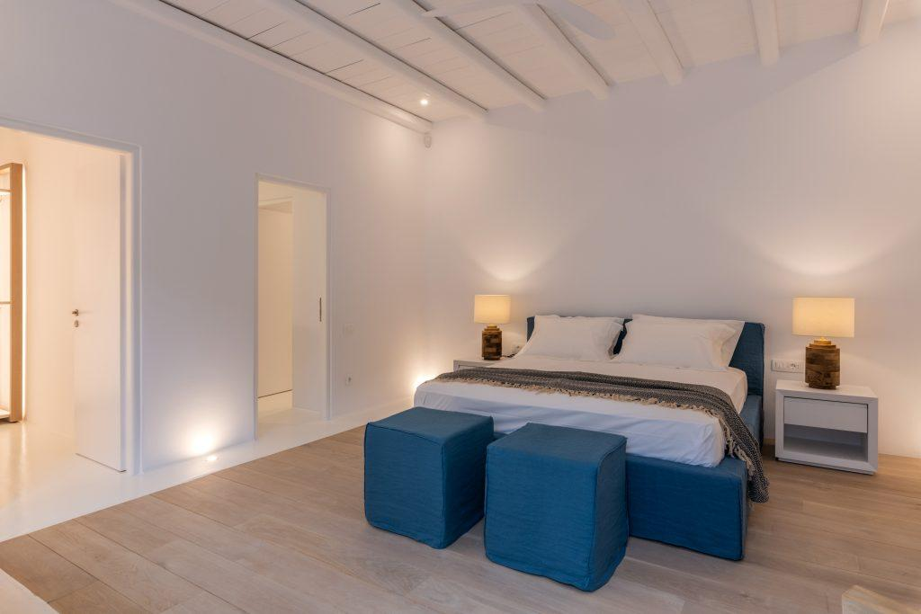 cozy laminate bedroom with white mattress blue bed and soft pillows
