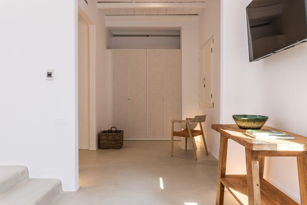 simply organized hallway with huge cabinet for your clothes and table with bowl for you to put necessities