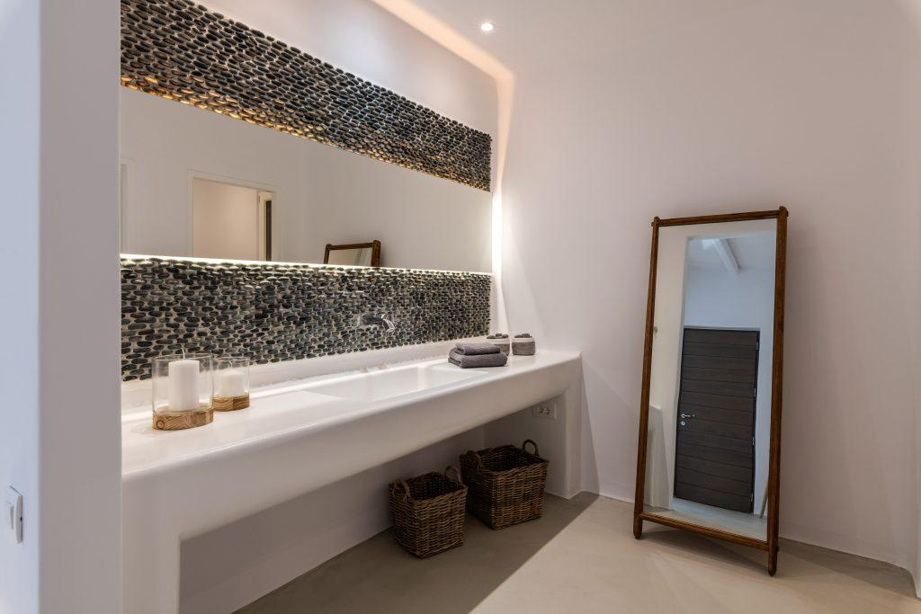 bright lamp and candle lighted bathroom with full length mirror