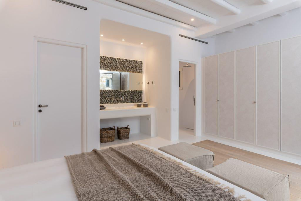 master bedroom with huge cabinet for your clothes and mirror for putting on make up