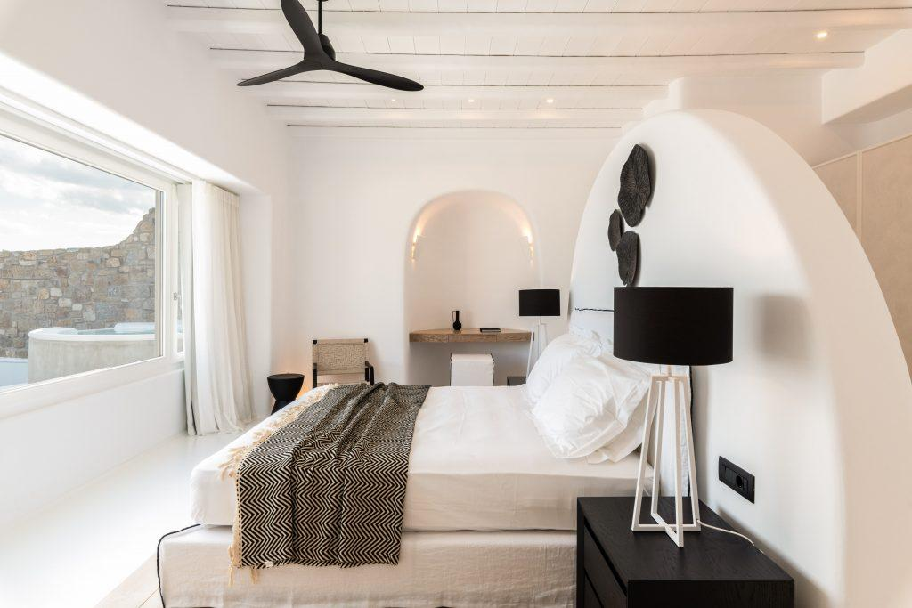 bedroom with double bed with ceiling fan to wake up to sea view and morning rays