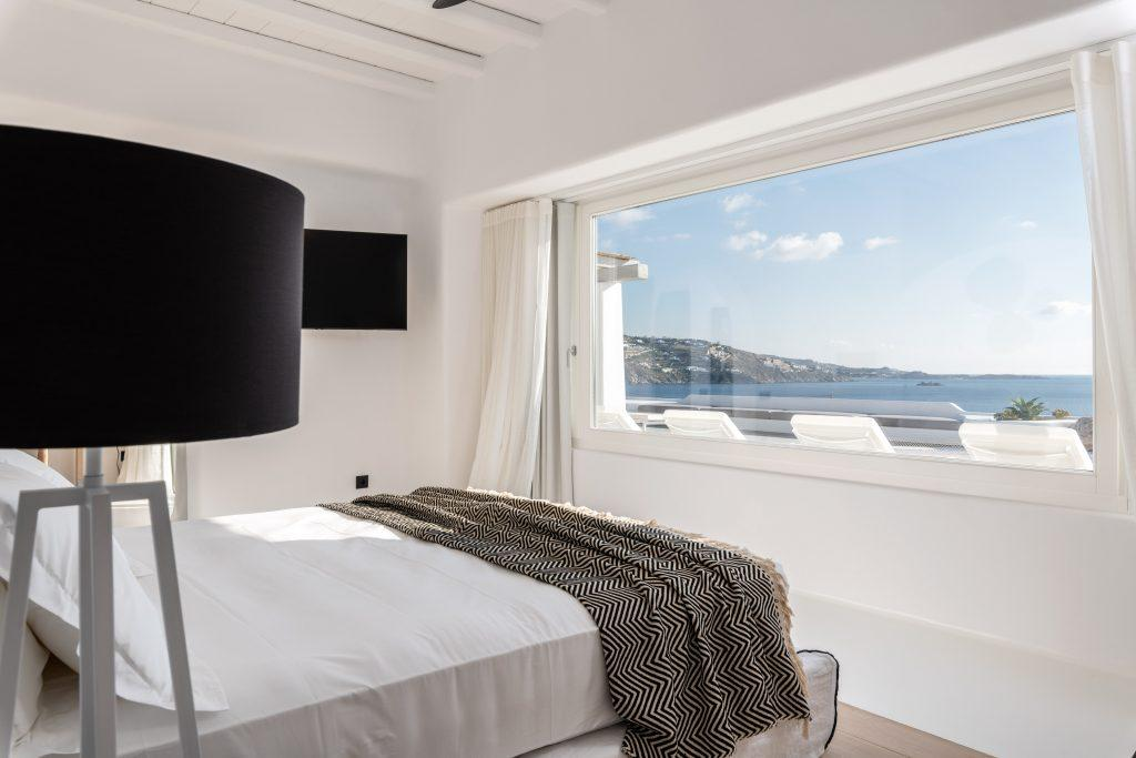 comfortable and cozy mattress king size bed facing stunning sea view