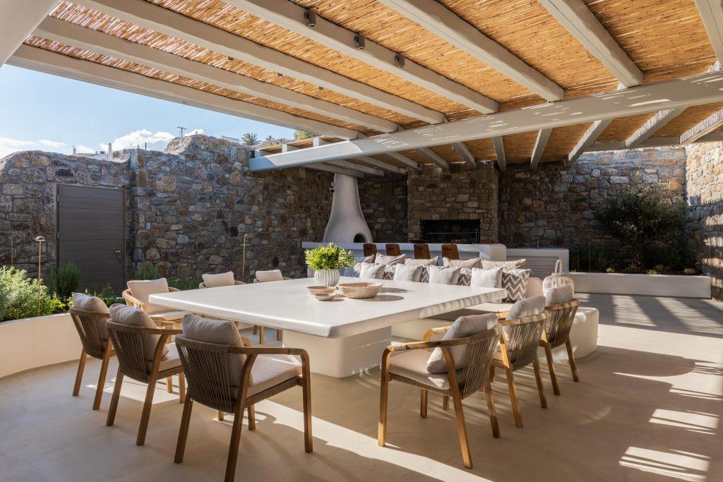 outdoor area with a large dining table ideal for an outdoor dinner with friends